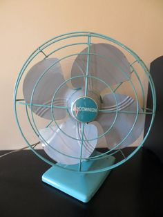 "Dominion Turquoise Fan-The one I bought in 2013 for 50 cents still has the advertising sticker on it! 12"", 2 speed, oscillating, desk or wall-mount fan-I'd guess 1960s."