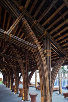 Vo Trong Nghia's naman bar combines bamboo, thatch and stone. part of the naman resort masterplan, the bamboo crafted beach-bar by vo trong nghia sits adjacent to the ocean as a relaxing space for guests to enjoy. Bamboo Architecture, Tropical Architecture, Sustainable Architecture, Architecture Details, Bamboo Roof, Bamboo Art, Bamboo Building, Natural Building, Feuille Aluminium Art