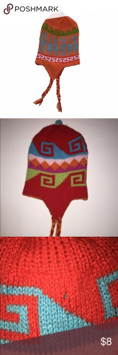 REVERSIBLE HANDMADE PERUVIAN HAT HANDMADE hat all the way from Peru! Size is about a 2T. Reversible (see pic for other side).  NWOT. Tiny hole on one side (see pic). All profits from sale of this item are donated to feed hungry Peruvian families.  *ask me to bundle your likes and save!  Tag: baby, toddler, knit, handcrafted Accessories Hats