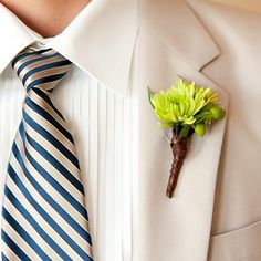 Steven wore a simple tan tux with a fantastic beige and navy plaid tie. His lime green kermit mums boutonniere provided a pop of color. - See more at: http://www.inblissweddings.com/gallery/image/7780/4?_id=181=true=image_popup=component#sthash.MRMGRfCC.dpuf - In Bliss Weddings