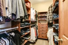 This closet looks classic and modern, with drawers, shelving and custom-fit racks.   This closest can be seen at 14921 Utah Place in the South Hamilton Estates neighborhood of Savage.  Marketed by Chad & Sara Huebener, Edina Realty.