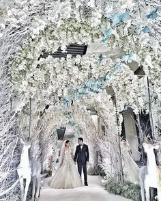 Two words to describe this wedding decor: simply breathtaking! Can't take our eyes off this white wedding indoor setup that really made our hearts skip a beat! Magical and enthralling we love how @rainforestthewedding turned the venue into this enchanted winter forest filled with the most beautiful white hued archs and a series of dreamy white branches and deer. What a total stunner isn't it? Don't you want to have this kind of decoration too? Double tap and tag a friend who would be…