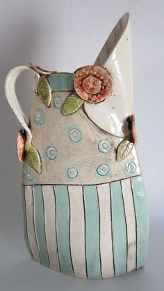 A quirky decorative ceramic jug, decorated with turquoise and white stripes and dots. Crafted red roses and leaves add a delicacy and Ceramic Pitcher, Ceramic Teapots, Ceramic Decor, Ceramic Design, Ceramic Clay, Clay Design, Hand Built Pottery, Slab Pottery, Ceramic Pottery