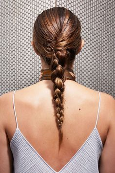 Tie it off with a clear elastic. If the hair at the nape starts to droop, slide some pins through the back of the braid and into the scalp. It will create a cool twisted effect, as seen here. #refinery29 http://www.refinery29.com/how-to-style-wet-hair#slide-25