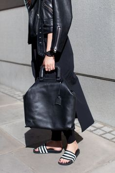 all black: leather jacket and dress dress, adidas sandals