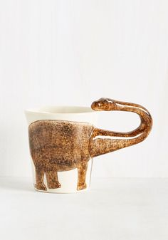 Making Prehistory Mug in Brontosaurus. With a specimen as excellent as this ceramic mug, museums will be vying to have it in their collection. #brown #modcloth