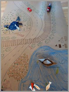 Draw a landscape for toys -- We do this outside with sidewalk chalk, so fun & creative!!