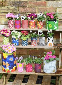 Create a riot of pattern and colour in your garden with some DIY Marimekko decorative tin can planters. This is a cheap and easy upcycle using paper napkin decoupage. diy garden cheap Easy Upcycled Marimekko Decorative Tin Can Planters Marimekko, Upcycled Crafts, Upcycled Garden, Recycled Cans, Diy Craft Projects, Garden Projects, Diy Crafts, Decoration Crafts, Craft Tutorials