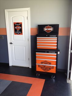 Harley Davidson Craftsman tool box, perfect for the Harley Garage. We added simple to install Race Deck flooring and color matched the paint to the flooring. Not bad for do it yourselfers! Harley Davidson Oil, Harley Davidson Motorcycles, Deck Flooring, Cool Garages, Harley Davison, Garage Makeover, Man Cave Garage, Motorcycle Garage, Locker Storage