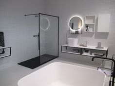 black and white bathroom small white titles  zwart witte badkamer kleine witte tegels    round mirror ronde spiegel