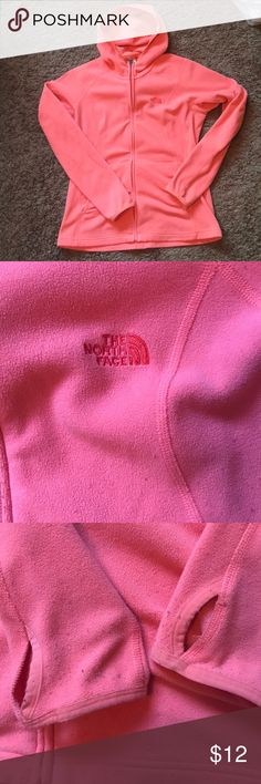 North Face Zip Up Hoodie In heavy used condition with pulling on arms and front as pictured. Color is orangeish pink. I'm a large in this photo. The North Face Jackets & Coats Utility Jackets