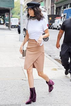 Nice kicks: The Keeping Up With The Kardashians star modeled purple velvet short boots