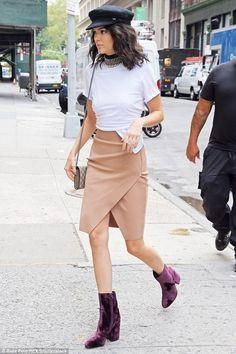Nice kicks: The Keeping Up With The Kardashians star modeled purple velvet short boots