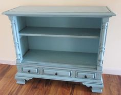 Old television console: electronics ripped out, cabinet fixed up and painted...gorgeous!