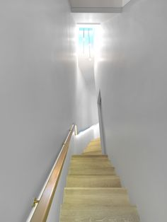 Finished with the same white Osmo oil, this staircase seamlessly leads you into the parquet used throughout the house.