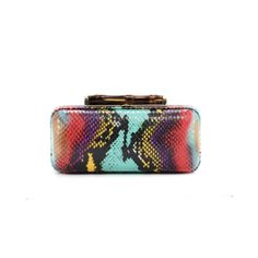 Bold, vivid colors make the Carnival Python Angelina minaudiere a glamorous bag to carry for day or night. Angelina's hard python case holds essentials like a cell phone, credit cards and lipstick, while making a fun statement. Carry the Carnival Python with all an all-white look for contrast, or pair it with like colors for a look to remember all season long.