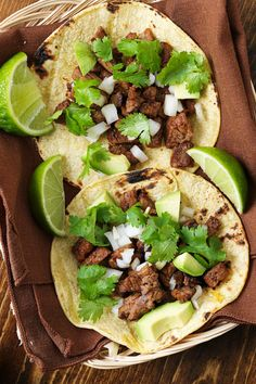 Two grilled steak tacos topped with cilantro and onion in a basket with a brown napkin inside Cubed Beef Recipes, Healthy Beef Recipes, Grilled Steak Recipes, Grilled Meat, Healthy Foods To Eat, Mexican Food Recipes, Cooking Recipes, Ww Recipes, Healthy Eats