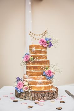Pronovias for a Vintage Wedding in Cheshire. Naked wedding cake with flowers. Image by Jessica O'Shaughnessy. Read more: http://bridesupnorth.com/2015/12/03/hessian-lace-pronovias-for-a-vintage-wedding-in-cheshire-sarah-anthony/