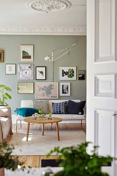 A calm Swedish apartment in green and cognac | 10 Amazing Gallery Walls - Tinyme Blog