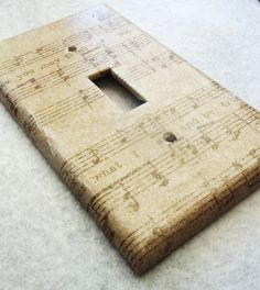 this is a good idea for a craft...use sheet music for decoupage and a light switch plate