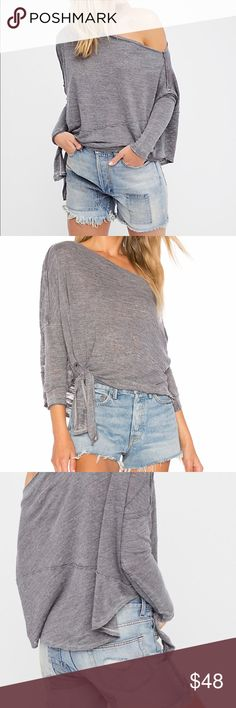 FREE PEOPLE We The FREE Love Lane Tee SMALL NWOT FREE PEOPLE We The FREE Love Lane Tee in Size Small. Washed Grey in Color. Worn Only Once and Hand Washed. Cute Side Tie with Off The Shoulder Flair. Super Soft and MINT Condition. True To Size Loose FREE PEOPLE Size Small Fit. $78 Free People Tops Tees - Long Sleeve