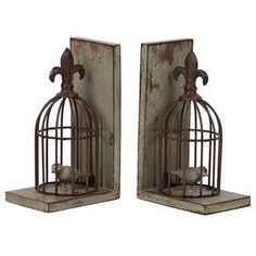 """Set of two weathered bookends with fleur-de-lis adorned birdcages.Product: Set of 2 bookendsConstruction Material: ResinDimensions: 10"""" H x 4.25"""" W x 6"""" D eachCleaning and Care: Wipe with clean damp cloth"""