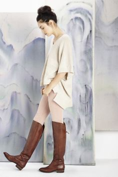 Brown riding boots add warmth to winter white palette