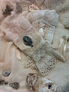 "❤~These look similar to French Lace Cuffs or as we might call them ""fingerless gloves"".  Not sure, but adore the layers of lace."