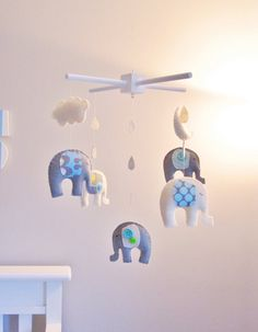 Elephants! Great idea for baby room and.......they're gray, my favorite color!