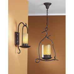 Colgante de 1 luz realizado en metal acabado marrón óxido, tulipa en forma de velón de piedra natural similar al alabastro. Bombillas Bajo consumo. Lámpara candela. 125€.