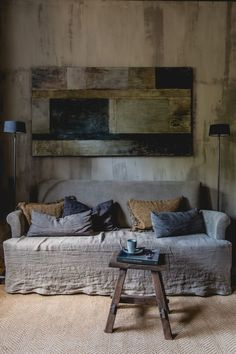 a wabi-sabi interior with a rough wooden wall, a wooden wall art of rough elements and a coarse textile sofa - DigsDigs Wabi Sabi, Wooden Wall Art, Wooden Walls, Casa Magnolia, Deco Champetre, Cottage Renovation, Japanese Aesthetic, Rustic Interiors, Interiores Design
