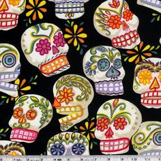 Jumbo-sized skulls are embellished with bright colors and bits of glitter. Just the thing to celebrate Dia de los Muertos! This quilting weight fabric is 100% cotton and is 43/44