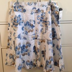 White Axcess Flared Skirt with Brown/Blue Pattern Adorable white Axcess skirt with a blue and Brown flower pattern. NET, never worn flared skirt, perfect condition! NO Trades NO PayPal Axcess Skirts A-Line or Full