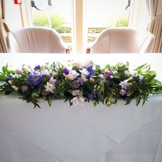 Long floral garland for the ceremony and Top table filled with wild and cottage garden flowers of deep purple, indigo, lilac and pink and a fragrance so sweet thanks to the jasmine and sweet peas x  #wedding #cotswolds #country #cotrage #garden #fragrance #perfume #jasmine #sweetpea #bride #lavender #purple #pink #botanical #nature #garland #ceremony #reception http://misstagram.com/ipost/1540467222228458371/?code=BVg1sbhD1uD