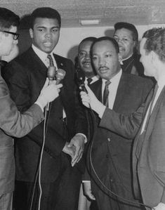 Heavyweight champion Muhammad Ali, left, is shown conferring March 29, 1967 with Dr. Martin Luther King, and King said later, the sooner this country does away with the draft, the better off we'll be. Ali was here for his court suit to prevent his Army induction April 28 in Houston. The court refused, however, to block his call-up. (AP Photo) Photo: Anonymous, STR / Beaumont