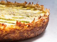 Get all the goodness of hash browns and a rich Fontina and goat cheese egg custard in this unexpected quiche. With fresh green asparagus and tarragon, it's perfect for a springtime brunch, lunch, or light dinner. Asparagus and two cheese quiche. Brunch Recipes, Breakfast Recipes, Brunch Menu, How To Make Quiche, Cheese Quiche, Goat Cheese, Cheese Dips, Breakfast Desayunos, Breakfast Casserole
