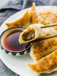 I love these homemade pan-fried Chinese dumplings filled with ground beef and sliced scallions. Also known as potstickers, they're fun to assemble, can be made ahead of time, and easy to cook.