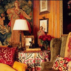 Paneled library with a 17th Century Flemish tapestry and a 19th Century Suzani used as a tablecloth -- Alidad Design