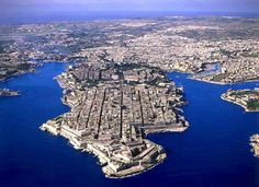 The islands of Malta are located in the middle of the Mediterranean Sea and carry a remarkable history that includes the Knights Templar.  The main island and city of Valletta in buttressed by Medieval fortress walls, historic siege forts and beautiful Medieval architecture throughout.  #malta #mediterranean #travel #bucketlist #medieval