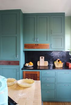 wonderful cabinet color and wicked backsplash. love the natural wood contrasting.