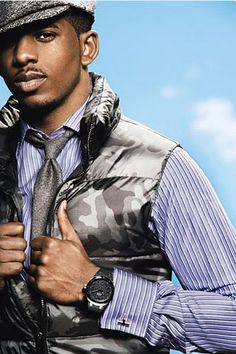 Gray camouflage vest paired w/ gray tie, hat, watch & blue striped French cuff shirt. Chris Paul knows style.