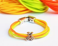 Neon pink yellow and green bracelet with silver bike by pureshapes, $10.90