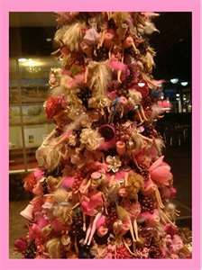 Plan on doing a Barbie themed Christmas tree in EK's room. Last year I bought both girls little pink trees for their rooms and they love them. Addie's theme will be cupcakes! :)