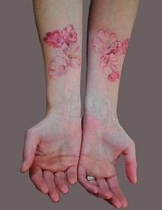 Watercolor pink dogwood tattoo.
