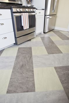 Marmoluem Floor in St. Paul Kitchen Remodel. Project 2405-1 - Castle Building & Remodeling, Inc.