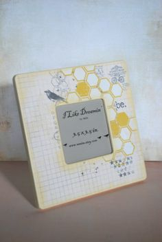"""Love this paper from My Mind's Eye """"Follow Your Heart"""". Great idea for a picture frame and you can make it yourself. We even have the unfinished frames!"""