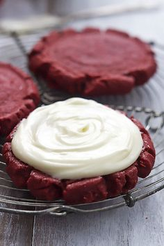 The BEST soft and moist red velvet sugar cookies with rich cream cheese frosting.