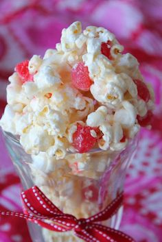 Valentine's Day Marshmallow Popcorn--this sweet and salty popcorn is so great for any holiday. Add Valentines day treats like cinnamon jellies, M's or any treat you would like to add a little festive flare.   Deals to Meals