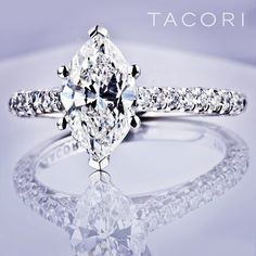 Marquise center stone with prong setting band.  TACORI