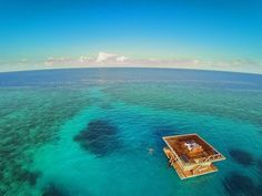 Sleep surrounded by an expanse of crystal-blue sea in the underwater room at the Manta Resort.